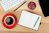 Coffee cup, red apple and office supplies