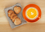 Cup with orange and cookies