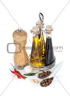 Olive oil, vinegar bottles, pepper shaker and spices