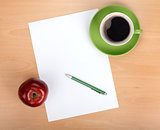Blank paper with pen, coffee cup and red apple