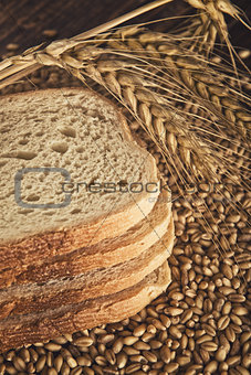 Bread slices, wheat ears and grains