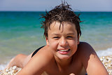 Happy young diver on the sea beach