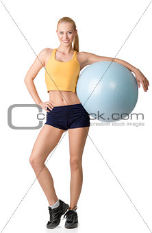 nice woman posing with fitness ball