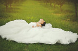 gorgeous  bride laying in garden