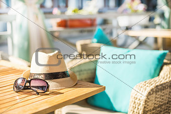 Beach items with straw hat and sunglasses