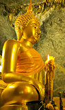 seated buddha in cave temple thailand