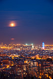 Barcelona at night with full moon, Spain