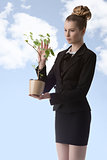 business woman with money plant
