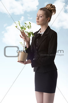 business woman with green money plant