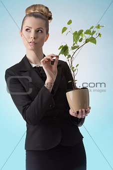 successful career girl with money plant