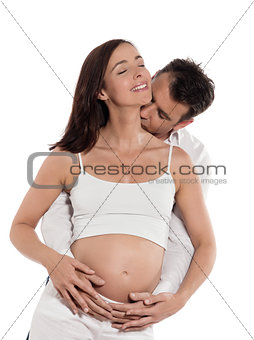 Couple Expecting Baby Kiss Tender