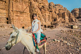 tourist riding donkey  in nabatean city of  petra jordan