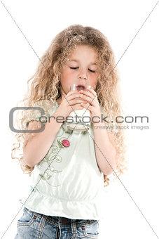 Little girl portrait drinking milk