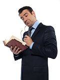 Man teacher reading holding old book thinking