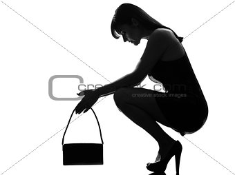 stylish silhouette woman crouching thinkig despair