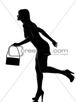 stylish silhouette woman running holding purse