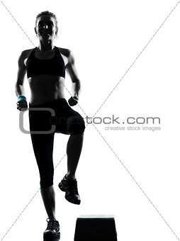 woman exercising step aerobics
