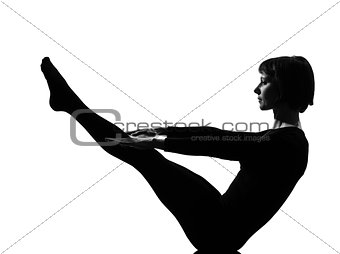 woman paripurna navasana boat pose yoga