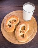 Homemade warm soft pretzels and glass of milk