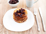 Delicious pancakes with cherry jam