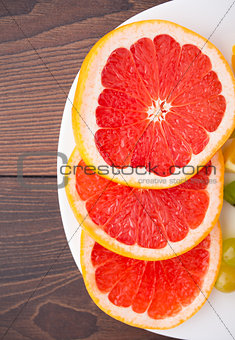 Slice of grapefruit on a palte