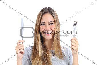 Beautiful woman holding a fork and a table knife