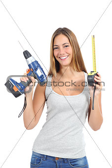 Beautiful woman holding a power drill and a tape measure