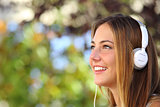 Beautiful woman listening to the music with headphones outdoor