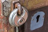 Steel lock on rusty gate