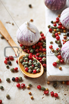 Assorted peppercorns and garlic bulbs