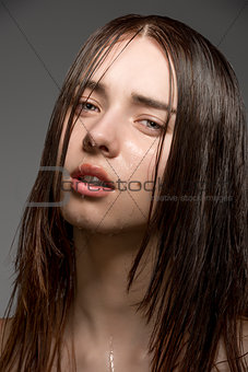 brunette girl with wet face