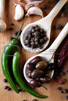 Olive and spices on wooden background