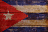 Cuba flag painted on wood aces