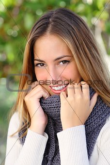 Close up of a beautiful woman smiling in winter