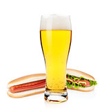 Beer glass and two hot dogs with various ingredients
