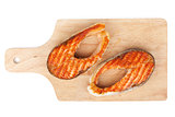 Grilled salmon steaks on cutting board