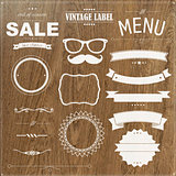 Set Of Vintage Badges With Wood Background