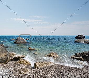 Black sea and stony beach