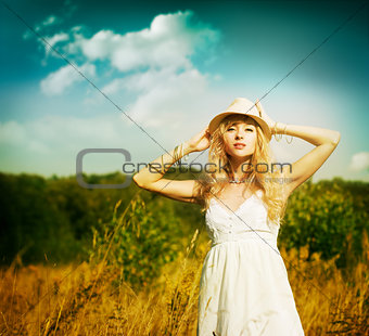 Portrait of Blonde Woman at Summer Meadow