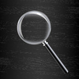 Magnifying Glass On Black Wooden Background