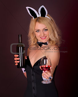 Beautiful young girl dressed as a rabbit with wine