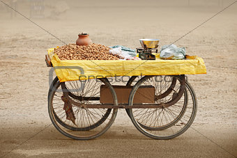 Counter to sell roasted peanuts. India.