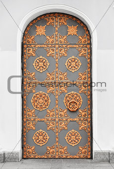 Antique door with gold ornaments