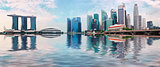 Singapore skyline with skyscrapers and reflection in water