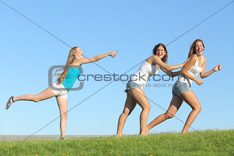 Group of teenager girls playing throwing water