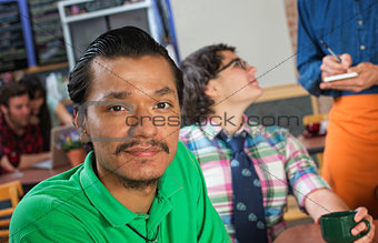 Handsome Asian Man in Cafe