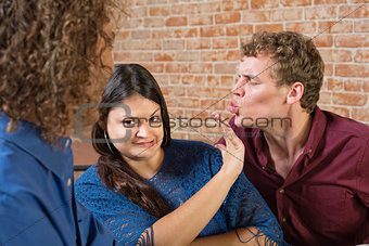 Woman Pushing Away Man