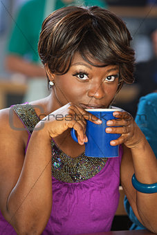 Pretty Woman Sipping Coffee