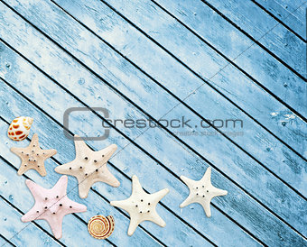 Starfishes on wood texture