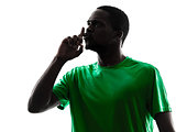 african man soccer player  hushing silhouette